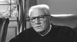 Spencer Tracy as Judge Dan Haywood, a fictional representative of those who presided over the Nazi War Crimes Trials following WWII.