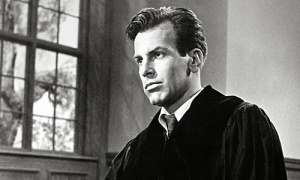 Maximilian Schell as Herr Rolfe, the fictional attorney who defended  four Nazi jurists who were on trial for falsely condemning numerous victims to death, imprisonment, and castration.